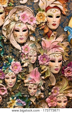Beautiful Venetian masks background, sales of many gorgeous decorated carnival masque