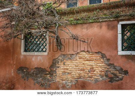 Old Vintage Red Brick Wall With Sprinkled Color Plaster Texture Background
