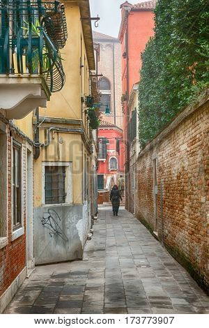 Famous romantic narrow streets of Venice in Italy