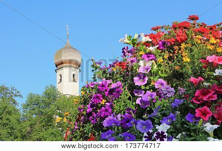 church tower and colorful summer flowers bavaria
