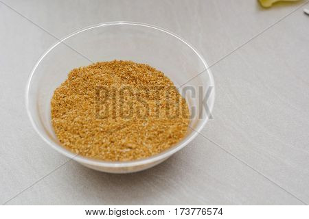 Pile of breadcrumbs isolated on white marble
