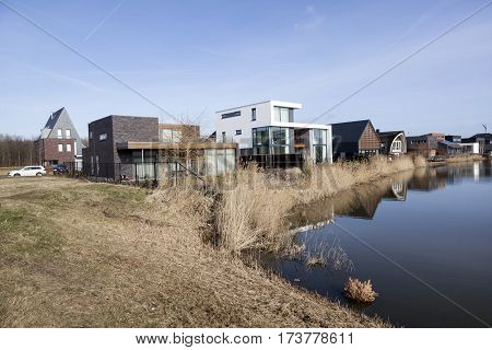 Almere, Netherlands, 21 february 2017: new houses and small lake in homerusbuurt in Almere Poort in the netherlands