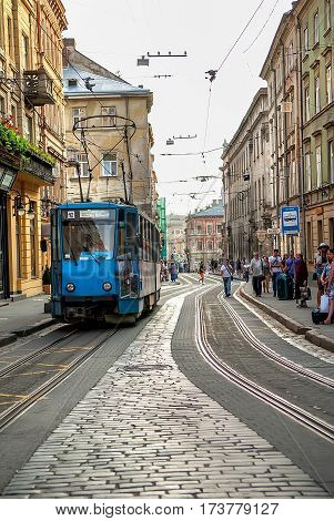 Lviv Ukraine - July 25 2016: Old tram is in the historic center of Lviv on the Ruska street. The architecture combines street renaissance baroque classicism and secession