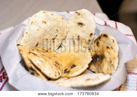 Fresh baked unleavened bread on white tray
