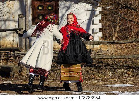 Kiev, Ukraine- Februar25.2017: Girls dancing on ethnic festival Maslenitsa. In natsyonalnyh costumes.