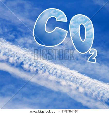 Symbol of carbon dioxide on blue sky with aircraft trails. Industrial background on climate change theme.