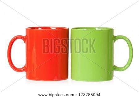 Two mugs - green and red - for coffee or tea, isolated on white background