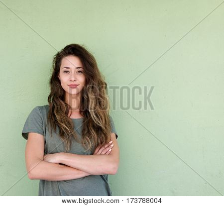 Young Confident Woman Standing With Arms Crossed
