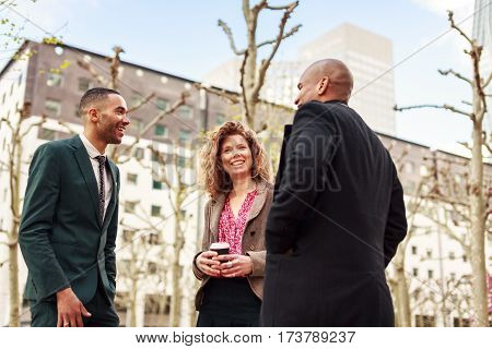 Business people talking in La Defense financial district, Paris, France