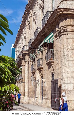Havana, Cuba - April 1, 2012: Tourists Walk Near Palacio De Los Capitanes