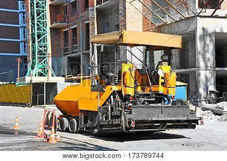 Yellow Asphalt Machine