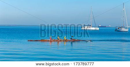 Cienfuegos, Cuba - March 30, 2012: Multicolor Rowing Team
