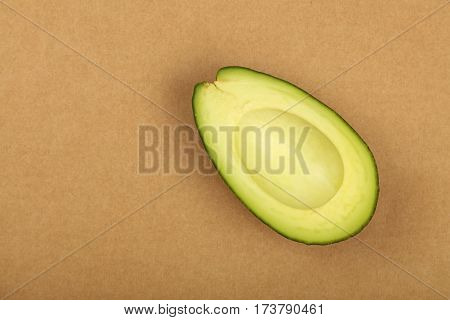 Fresh Ripe Green Avocado On Brown Paper Parchment