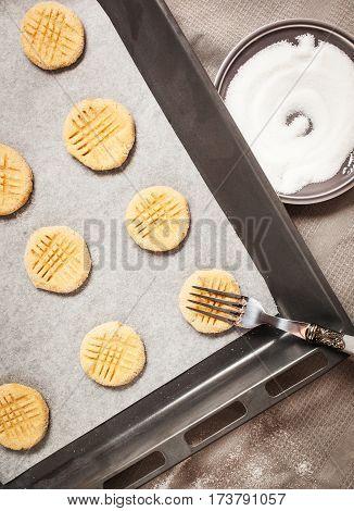 Raw Peanut Butter Cookies On Baking Sheet