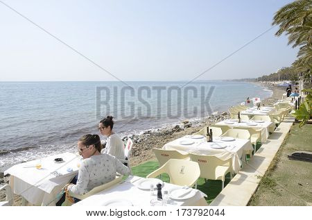 MARBELLA, SPAIN - FEBRUARY 26, 2017: Outdoors restaurant at the shore of the beach in Marbella Andalusia Spain