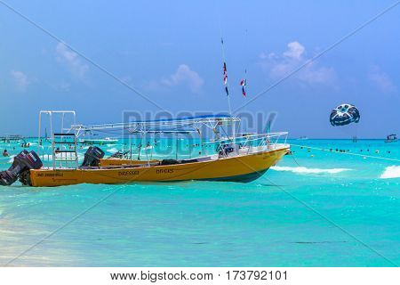 PLAYA DEL CARMEN, MEXICO - JULY 13, 2011: Yellow speedboat on the beach of Playacar at Caribbean Sea of Mexico. This resort area is popular destination with the most beautiful beaches.
