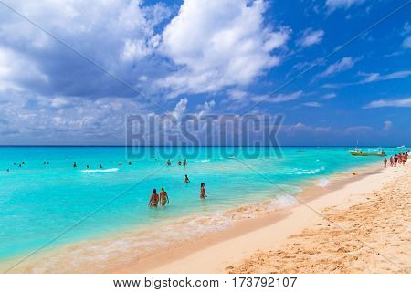 PLAYA DEL CARMEN, MEXICO - JULY 11, 2011: Unidentified tourists on the beach of Playacar at Caribbean Sea of Mexico. This resort area is popular destination with the most beautiful beaches.