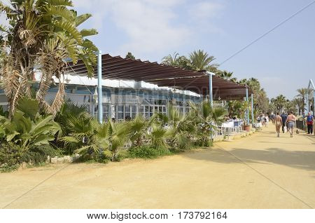 MARBELLA, SPAIN - FEBRUARY 26, 2017: Blue and white beach restaurant at the promenade in Marbella Andalusia Spain.