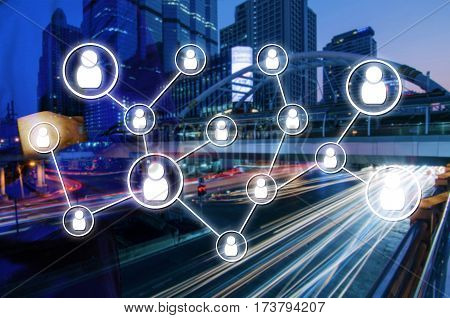 double exposure of man crossing arms with icon social media concept on blurred night city background, color tone effect.