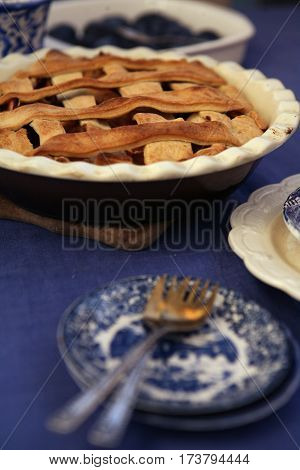 home made fresh american apple pie on the blue tablecloth