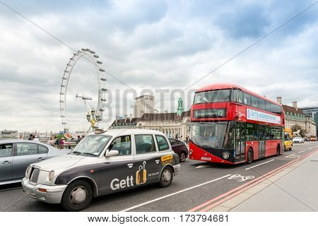 LONDON, UNITED KINGDOM - June 21, 2016. Street view of  London Eye and River Thames London, United Kingdom