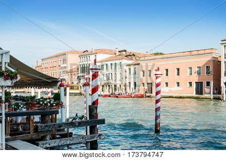 VENICE,ITALY-June 30, 2016.Tourists on water street with Gondola in Venice on June 30, 20165. its entirety is listed as a World Heritage Site, along with its lagoon.June 30 VENICE,ITALY
