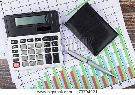 Printout With Diagrams, Electronic Calculator, Notepad And Ballpoint Pen
