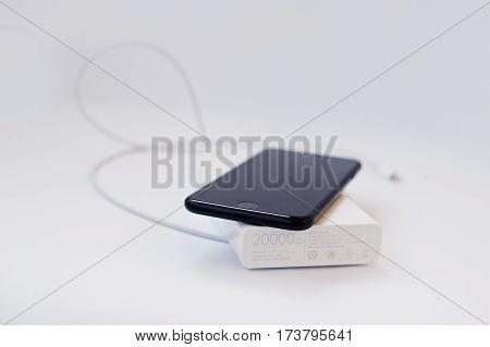 Hai, Ukraine - February 28, 2017:  Xiaomi Power Bank 20000 Mah With Apple Iphone 7 Isolated On White