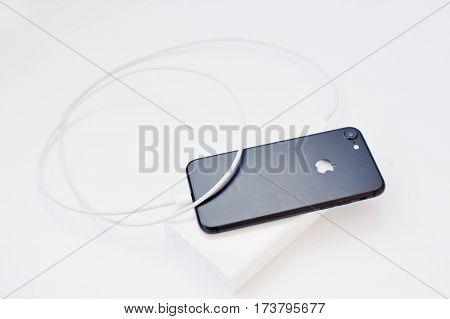 Hai, Ukraine - February 28, 2017:  Apple Iphone 7 Charged From Xiaomi Power Bank 20000 Mah Isolated