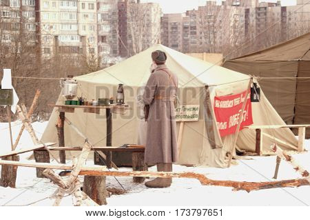 26.02.2017. Saint-Petersburg. Military-historical festival. Reenactment. Old Soviet military equipment and uniforms. Military tent a fire a samovar.