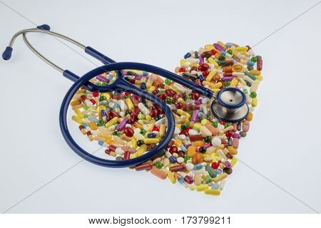 stethoscope and pills in heart shape poster
