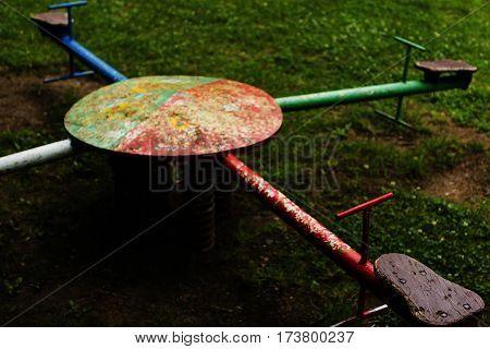 Old seesaw, outdoor playing equipment (kindergarten, preschool)