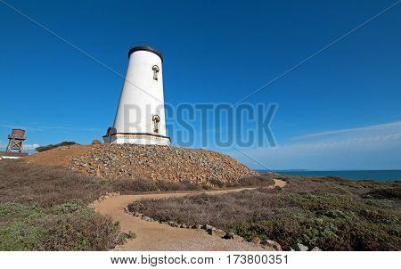 Piedras Blancas lighthouse and S shaped walkway on the Central California Coast north of San Simeon California USA