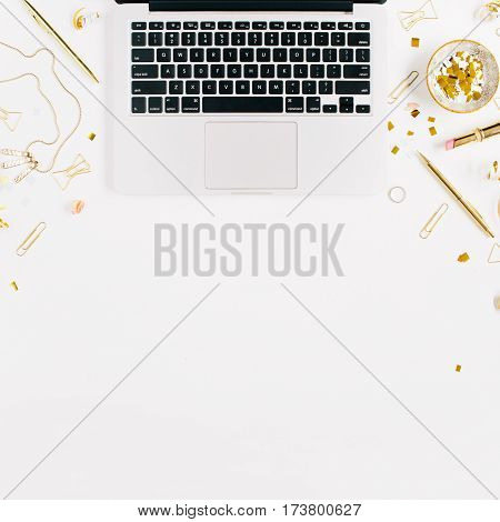 Beauty blog background. Workspace with laptop gold style feminine accessories. Golden tinsel scissors pen rings necklace bracelet on white background. Flat lay top view office table desk.