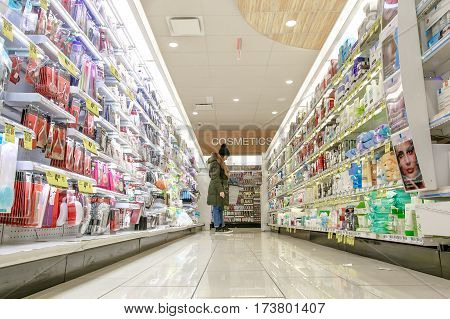 New York February 26 2017: A woman is shopping in a Rite Aid pharmacy.