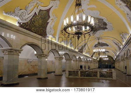 Moscow Russian Federation - July 24 2012: The Moscow metro station Komsomolskaya. With the grandiose painted yellow and the ceiling decorated with stucco floral motifs and mosaics depicting Russian military heroes of the past.