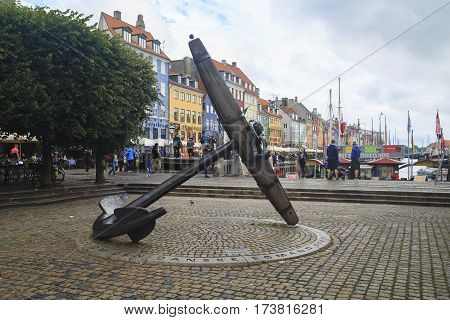 COPENHAGEN, DENMARK - JUNE 29, 2016: This large anchor is a monument to Danish sailors who died during the Second World War in Nyhavn.