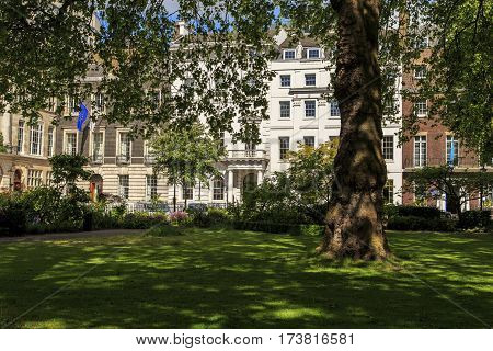 LONDON, GREAT BRITAIN - MAY 12, 2014: This is park on the St. James square which in the past was the most fashionable and popular among aristocrats place to stay.