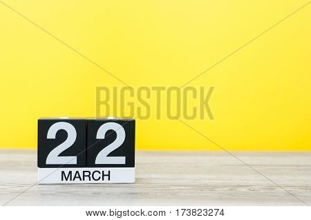 March 22nd. Image of march 22 wooden color calendar on white background. Spring day, empty space for text. World Day Of taxi service.
