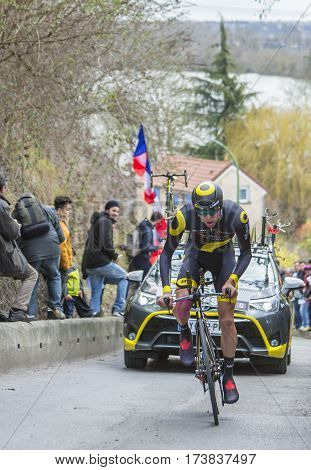 Conflans-Sainte-HonorineFrance-March 62016: The Canadian cyclist Antoine Duchesne of Direct Energie Team riding during the prologue stage of Paris-Nice 2016.