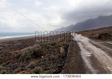 Road to Cofete Beach with mountains in the clouds - Jandia, Fuerteventura, Canary Islands, Spain