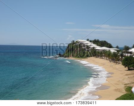 Coastline in the Caribbean island of Antigua. clear blue waters and soft white sand
