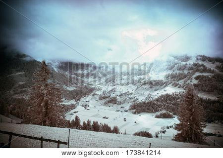 infrared shot of alpine landscape in the simmental valley. photo taken with a modified canon 40d camera.