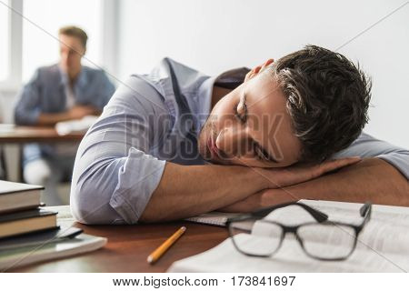 Students during the class. Guy in the foreground is napping on the desk