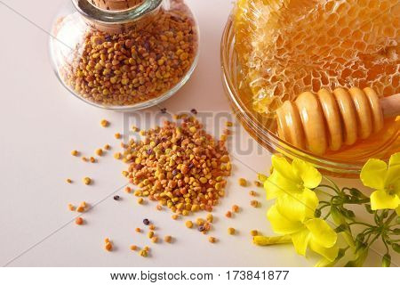 Containers With Honey Honeycomb And Pollen Bee Top Close Up