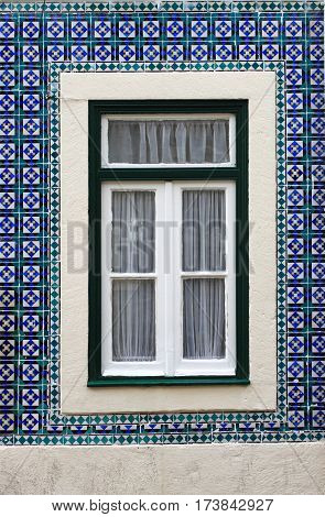 Typical portuguese window with azulejo tiles in Lisbon, Portugal