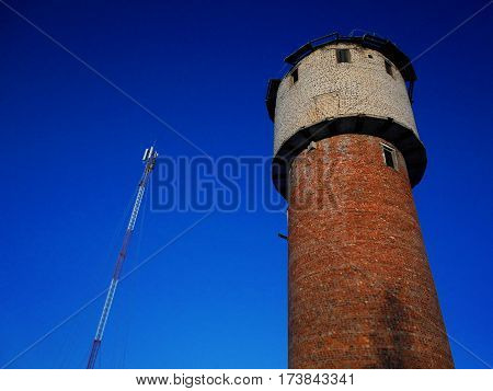 Tower and TV tower against blue sky