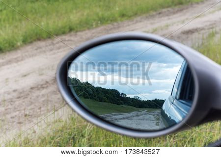 Rearview Mirror With Blue Sky Behind