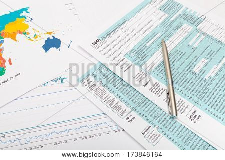 Us 1040 Tax Form And Silver Ball Pen Over It - Close Up Studio Shot