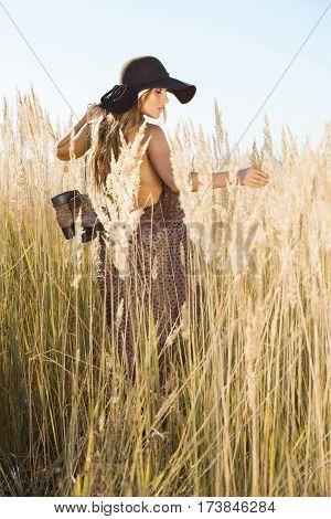 Beautiful Young Model Walking Through Tallgrass